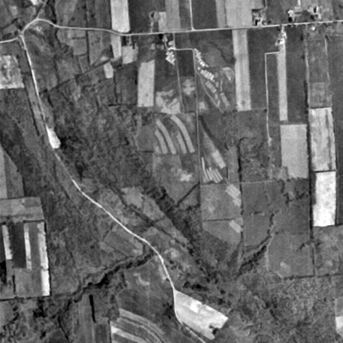 Aerial view of USDA Soil Management Research Farm and Gully Road properties, April 16, 1957.  USGS.
